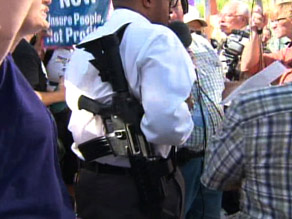 From CNN: Black man carrying assault rifle outside Obama town hall meeting